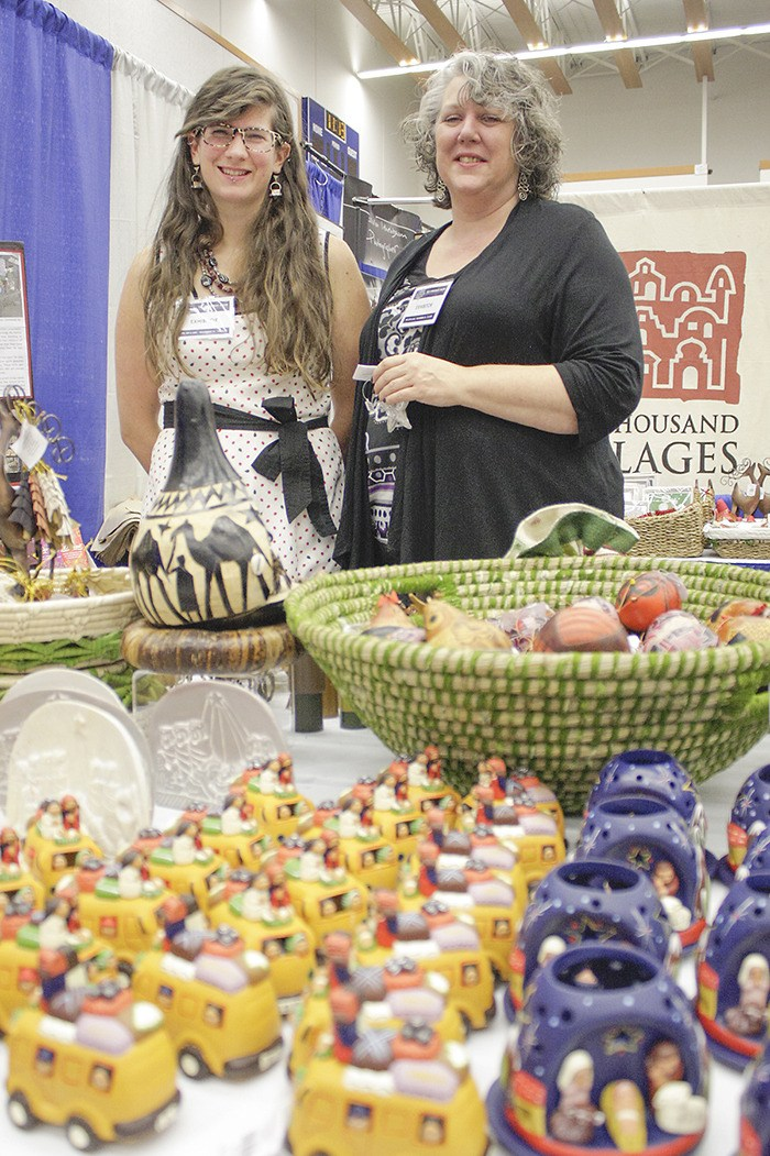 Trish Buhler (left) and Denise Ramsay (right) from the Ten Thousand Villages fair trade shop on the one-way in Langley brought some of the products the store purchases from artisans in emerging nations to the second annual Christmas Show at the Langley Events Centre on Sunday.