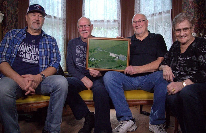 Siblings Victor, George, Roger and Yvonne Beaulieu inside Langley's historic Michaud House.