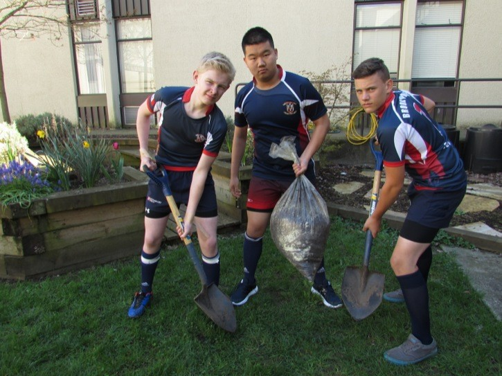Brookswood rugby players Quintan Morley (left to right), Philip Lee Caleb Gerth will be selling mushroom compost this weekend as a fundraiser for the program's tour to California next spring.