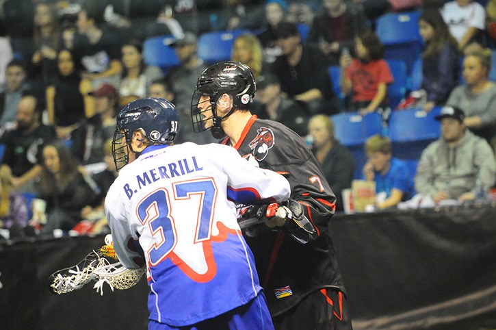 Vancouver Stealth's Tyler Digby (right) battles with Toronto Rock's Brodie Merrill during the Stealth's home opener at the Langley Events Centre on Jan. 10. Digby had two goals and an assist in his team's most recent game, a 20-9 setback at the hands of the Colorado Mammoth. The Mammoth are at the LEC on Jan. 31 as the Stealth look to improve on their 1-3 record.