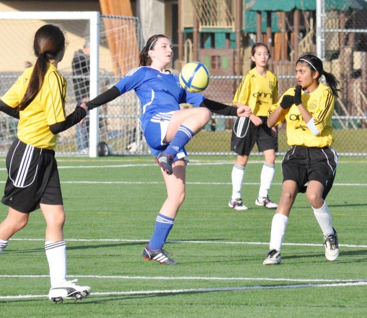 Langley Knockouts' Kelsey Neil makes a play with the ball against her Coquitlam opponents during a U15 Coastal Cup game on Sunday at Willoughby Community Park. The Knockouts won 4-0 and face their next Cup game in January.