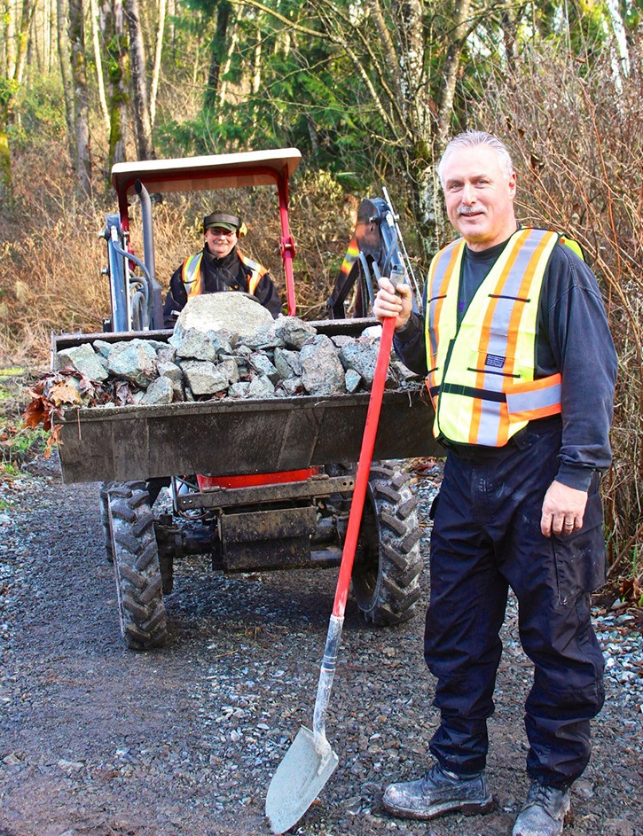 Dave Grant (on tractor) and BCHBC Aldergrove vice-chairman Peter Thiessen were just two of the 25 volunteers from the club who spent Sunday working on the multi-use South Langley Trail. Thiessen said other organizations that will benefit from the trail had been approached in the past to contribute to the trail's completion effort, but to date Aldergrove's BCHBC is the only club providing volunteer workers.