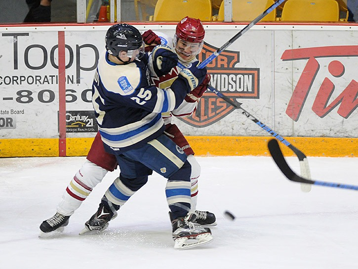 Jordan Kawaguchi of the Chilliwack Chiefs gets tangled up with Brendan Budy of the Langley Rivermen during Game 2 of the first round of the BCHL playoffs at Prospera Centre on Saturday.