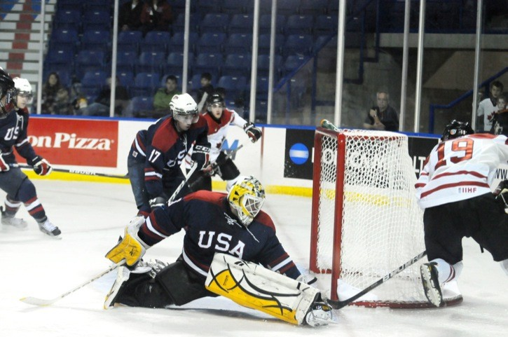 Canada East forward Devin Shore tucks the puck between U.S. goaltender Ryan McKay and the near post during the third period of the team's semifinal game on Nov. 17 at the World Junior A Hockey Challenge at the Langley Events Centre. The goal was Shore's second of the game in the 4-2 victory.