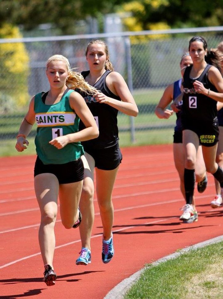 Langley Saints'  Georgia Ellenwood leads Walnut Grove Gators' Danica Matson and Shelby Smithson (#2) during the 800m race, which was part of the heptathlon event over the weekend at Abbotsford's Rotary Stadium. Ellenwood won her third consecutive provincial title in the heptathlon while Smithson was fourth and Matson fifth.