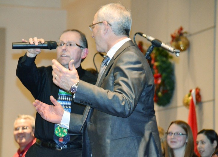 Newly-elected Langley Township Mayor Jack Froese came on stage to perform with Peter Luongo and the Langley Ukulele Ensemble as they performed for members of Greater Langley Chamber of Commerce at its Christmas gathering Tuesday. They also reminded people interested in seeing the well-known ensemble's Christmas concert that tickets are still available for this Saturday's performance in Langley, at St. Andrew's Anglican Church. There is a matinee at 4 p.m. and evening concert at 8 p.m. Tickets are available by calling 604-340-8537 (UKES) or by e-mail to tickets@langleyukes.com.