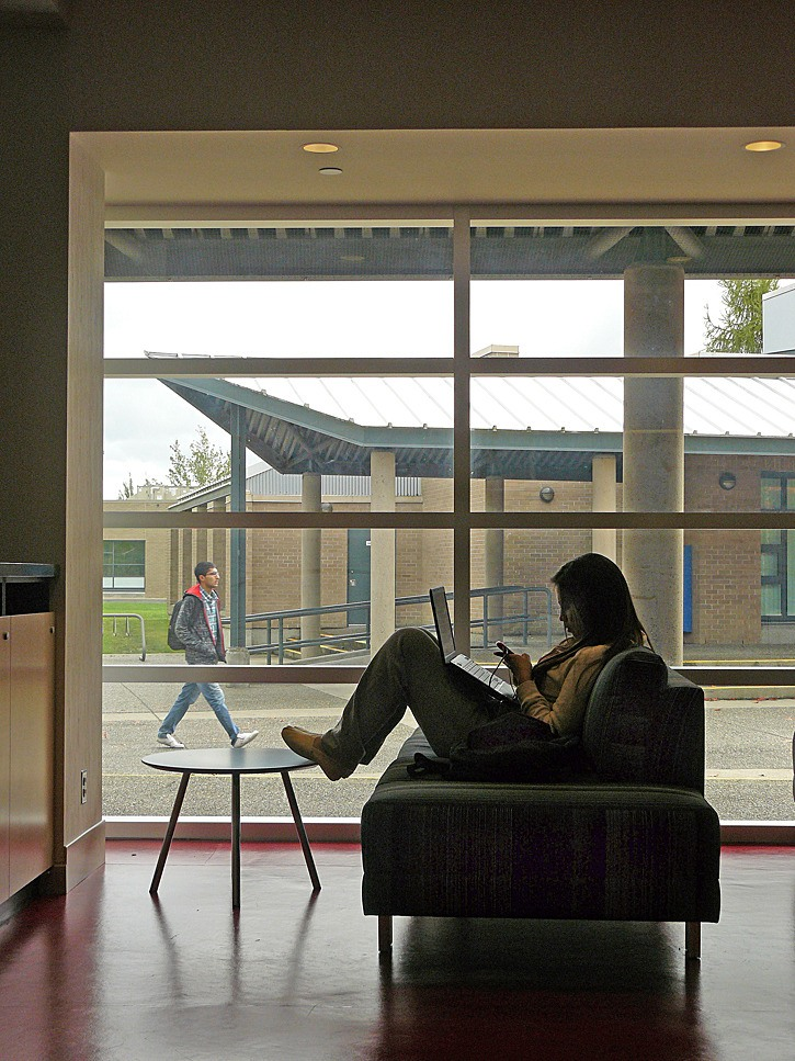 Kwantlen Polytechnic University student Christina Bieker, 17, relaxes in the new student gathering place at the Langley campus. The renovated west wing was officially opened Wednesday, Oct. 12.