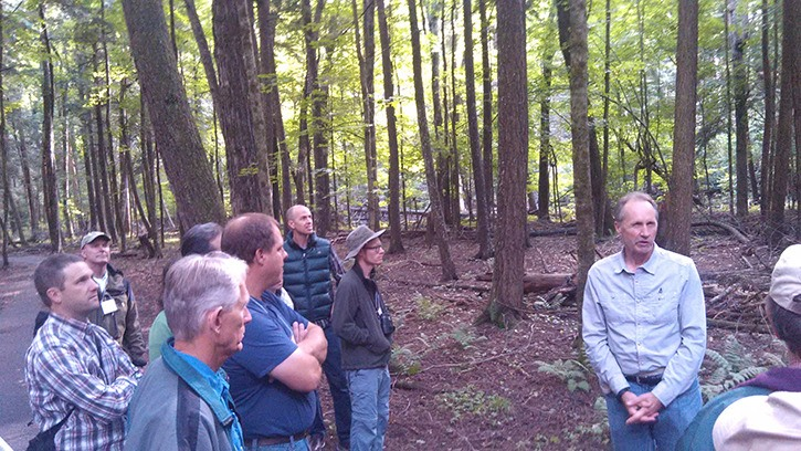Fred Van Dyke (right) speaks to the group at the Au Sable Institute of Environmental Studies in Michigan's Hartwick Pines State Park.