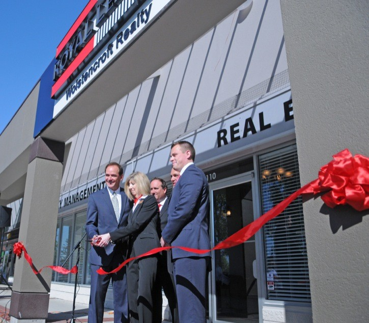 Royal LePage CEO Phil Soper and executive staff cut the ribbon on the new Wolstencroft Realty office on Willowbrook Drive.