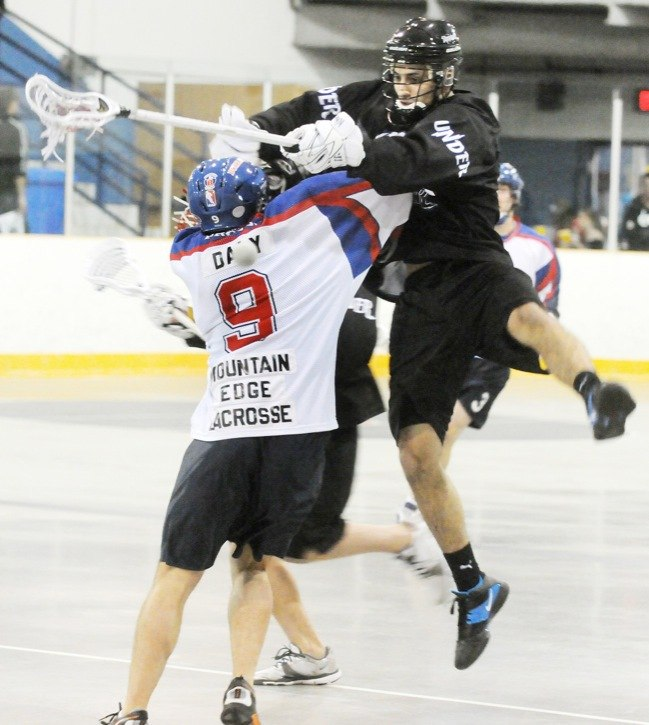 Langley Thunder's Nik Bilic and Maple Ridge Burrards' Randy Daly collide during Western Lacrosse Association action on Sunday night at Maple Ridge's Planet Ice. The senior A Thunder fell 9-6. The team's home opener is Wednesday (May 25) when they host the Coquitlam Adanacs at the Langley Events Centre.