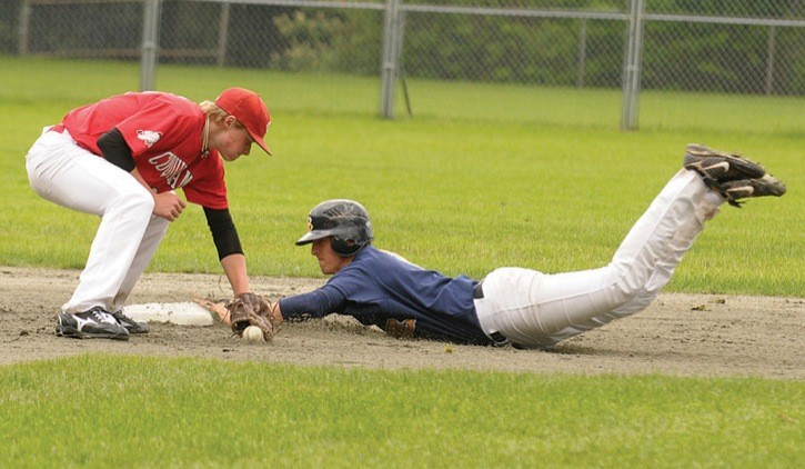 Greg Rodgers of the Langley Blaze slides head first into second base as the Coquitlam Reds infielder Darren Honeysett covers in a BC Premier Baseball League game Sunday at Mundy Park. The first-place Blaze swept a doubleheader, 11-0 and 9-4.