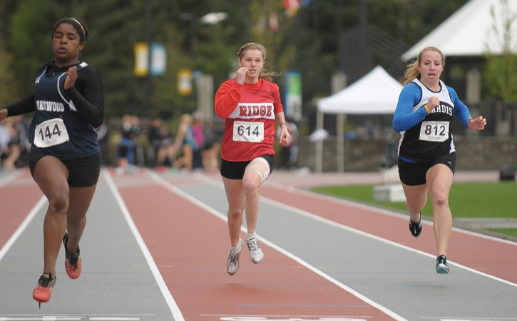 Brookswood Bobcats' Carolyn Sutherland (left) leads Maple Ridge's Danielle Giesbrecht and Sardis' Robyn Kempers in the girls' 100m heat at the Fraser Valley track and field championships at the Coquitlam Town Centre Stadium. Sutherland went on to win the silver medal in the event as well as gold medals in the long jump and the 4x100 relay event. For complete results, visit www.fraservalleytrack.com.