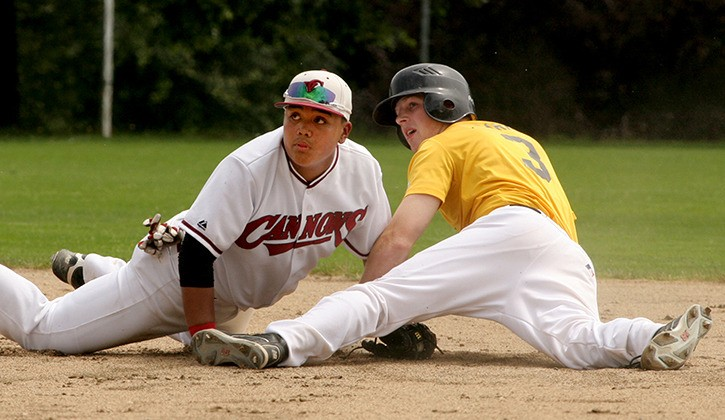 Langley Junior Blaze's Shayne Clarke slides safely into second base ahead of the tag from Vancouver Junior Cannons infielder Justin Maunahan during a game earlier this season. Both teams will be among the eight competing at the provincial championships this week at McLeod Park.
