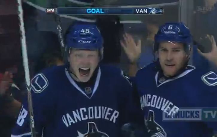 Hunter Shinkaurk celebrates with Yannick Weber, after the Medicine Hat sniper scored in his first (preseason) appearance with the Vancouver Canucks.