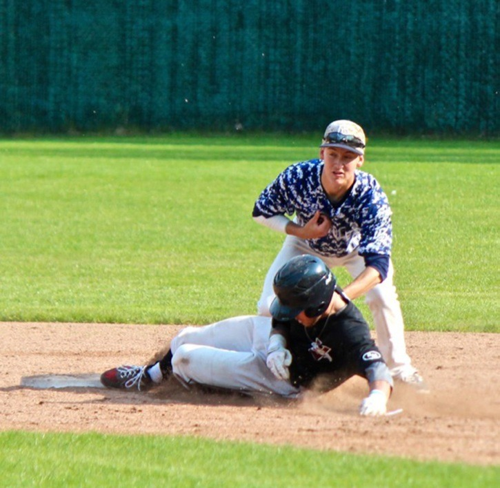 Langley Blaze second baseman Dayton Wilson tags out a Victoria Eagles' base-runner during the teams' second game of a doubleheader on Saturday afternoon at McLeod Park. The Blaze won both games and improved to 7-1 on the season.