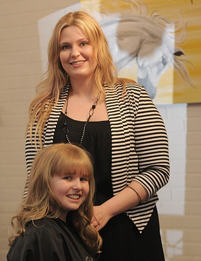 Jade Elias styles Tiahna Cannon's hair at the Beauty Lounge Salon and Spa on Sunday. The Fraser Highway business donated all proceeds from that day for the Hope International Development Agency, raising $2,066.