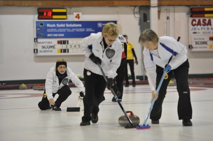 B.C. skip Karen Lepine of Langley delivers a shot during the final of the 2015 Canadian Masters Curling Championship in Whitehorse, Yukon, on Sunday. Lepine won gold with a 4-3 win over Ontario.
