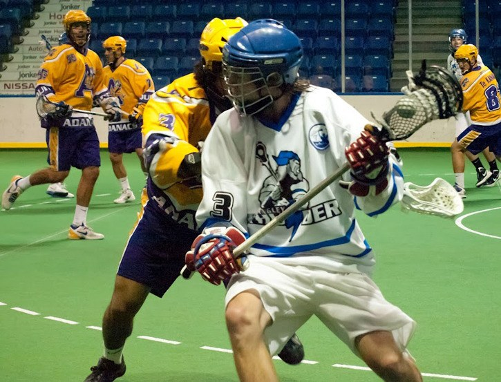 Langley Junior Thunder's Brian Gillis fends off Coquitlam Junior Adanacs' Jeff Cornwall during game two of the teams' best-of-five playoff series. Coquitlam won 15-4 to take a 2-0 series lead.