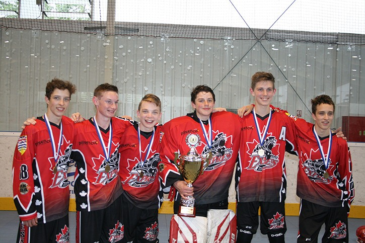 Six Langley teens were part of the West Coast Express ball hockey team which won gold in the Czech Republic.