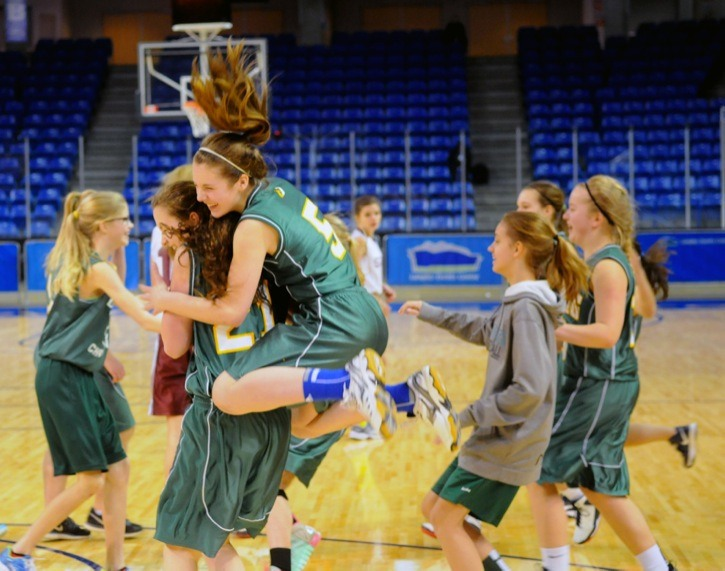 Langley Christian Lightning's Tia Tuininga hops onto Grace Wergeland's back to celebrate their team's victory in the Grade 8 girls Langley district championship game at the Langley Events Centre last week (Feb. 6). The Lightning defeated the H.D. Stafford Skyhawks 24-14. See story page 18.