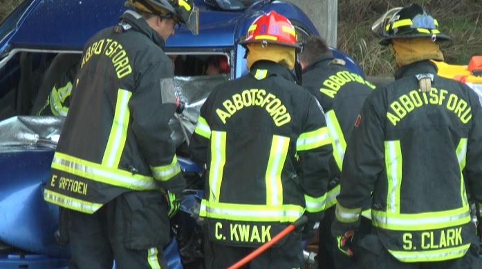 Emergency crews work to free a driver trapped in a vehicle following a crash on Highway 1 near Mt. Lehman on Sunday morning.