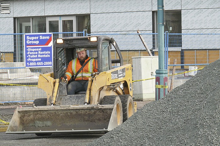 Work is underway on Douglas Crescent in front of the under-construction Timms centre in Langley City.  The project includes the removal of the existing median and installation of a traffic light, which will provide drivers access to the new centre's underground parking lot, as well as allow left-turn access to both the recreation centre and the Langley Mall.