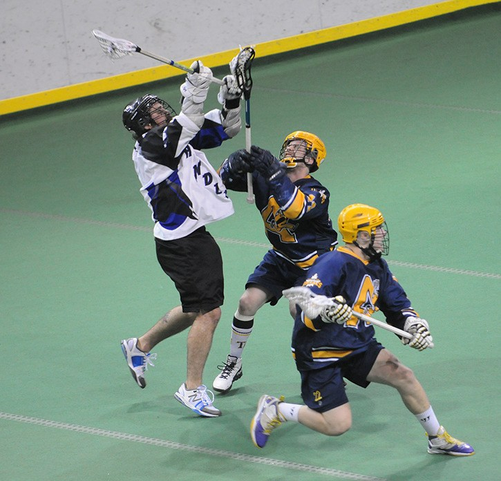 Langley Thunder captain Matt Leveque (left) levels Coquitlam's Dane Dobbie during game 5 of the WLA championship series. Leveque was assessed a five-minute high-sticking penalty on the play.