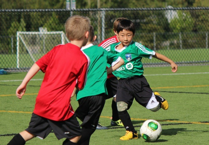 Langley FC Green Goblins player Allan Son has the ball in an U8 game against the Albion FC on Sept. 27 at Willoughby Community Park.
