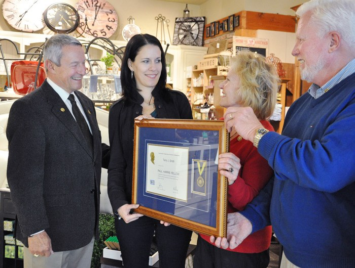 Karla Barton (second from left) is presented the Paul Harris fellowship by Grace Robertson and Terry Smith of the Rotary Club of Langley Central (right) and Mayor Peter Fassbender.