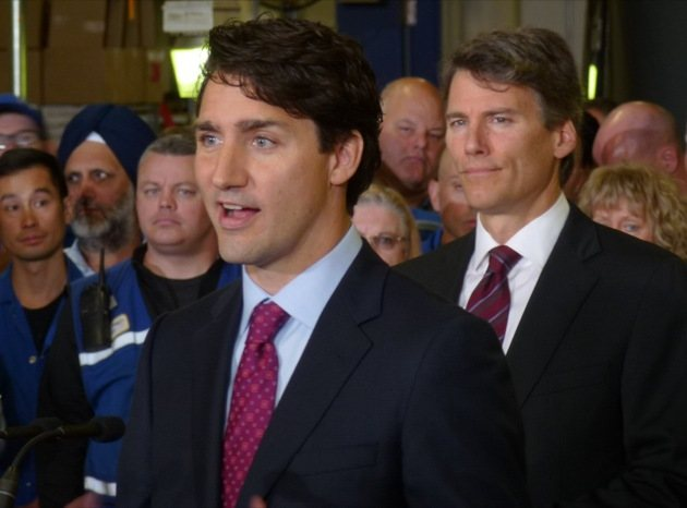 Prime Minister Justin Trudeau with Vancouver Mayor Gregor Robertson at the SkyTrain operation and maintenance centre in Burnaby Thursday.