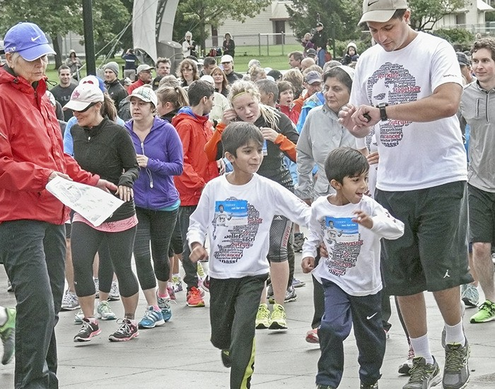 Terry Fox Run participants begin the 35th annual fundraiser for cancer research in Langley City on Sunday morning. Despite the wet and windy weather, attendance and donations were up. There were 203 participants registered and $9,000 was raised.