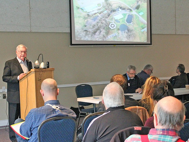 Bob Donnelly, president of the Semiahmoo Fish and Game Club, addresses the crowd at a community meeting about the proposed truck-parking facility Dec. 6.