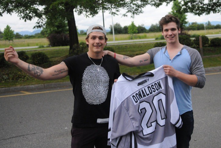 Jake (left) and Stefan Virtanen proudly display the tattoos they got (below) in memory of their late friend, Ryan Donaldson. The Langley teen took his own life in February, 2014. This weekend marks the second annual Ryan Donaldson Memorial Hockey Tournament at the Langley Sportsplex.