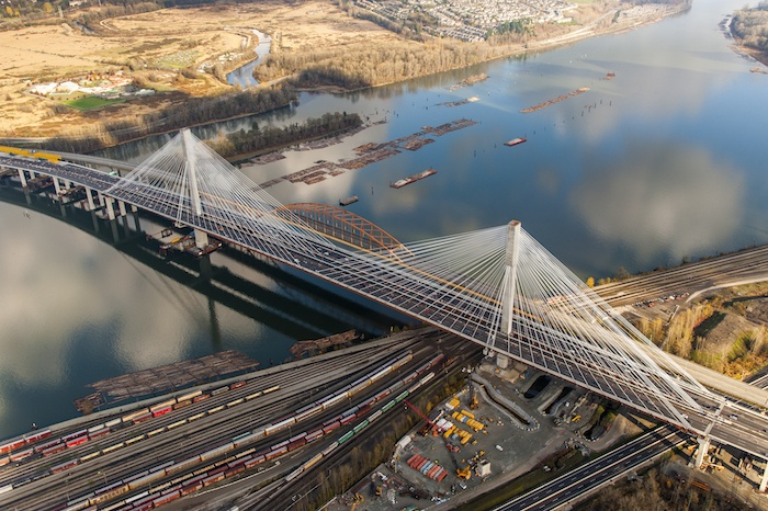 The new Port Mann Bridge will soon lose its older companion. The iconic orange arches of the old bridge will begin to be dismantled this summer.