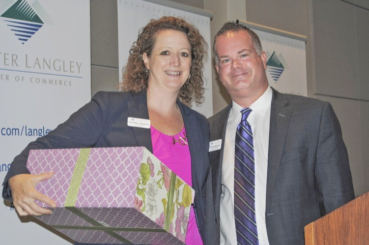 Kristine Simpson receives a gift from incoming Greater Langley Chamber of Commerce president Scott Johnston at the Chamber's annual general meeting on June 16.