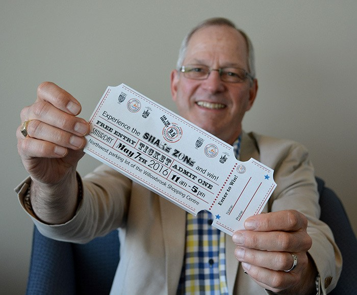 Township Mayor Jack Froese holds up a ticket to Shake Zone. The tickets, available in this Friday's Langley Times can be used to enter draws for grab-and-go earthquake preparedness kits.