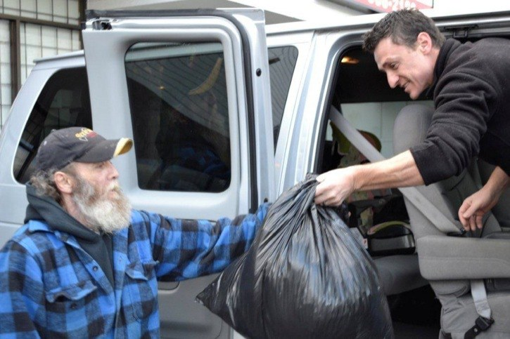 Realtor Gary Foltyn unloads a van full of donations to volunteer Deni at the Night Shift Ministries in Surrey. Deni is a former client and remembers receiving a coat from the Realtors Care Blanket Drive.