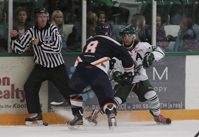Jamie Vlanich (right) braces for a hit from Beaver Valley's Fraser Stang during a KIJHL game earlier this season. The Langley Rivermen have signed Vlanich, a high-scoring forward.