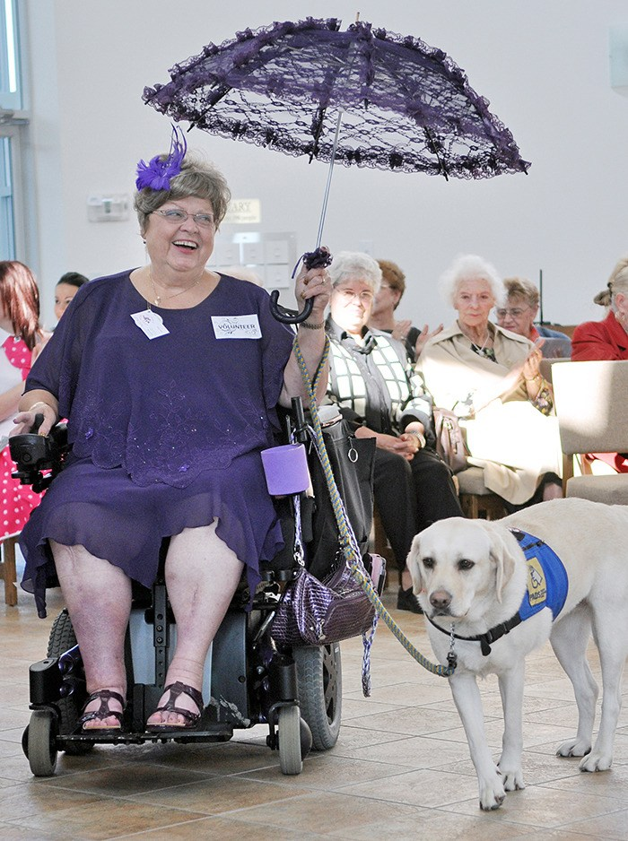 Langley Pos-Abilities president Zosia Ettenberg and her service dog Rumour showcased her purple dress and parasol during a past fashion show fundraiser. The 2016 fashion show is taking place on Tuesday, June 7.