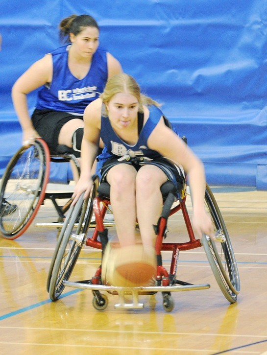 Erin Higgins (front) and Leanne Kelly are able-bodied players for the all-girls wheelchair basketball team, the BC Breakers. The team took part in a wheelchair basketball tournament at Trinity Western University on Nov. 27.