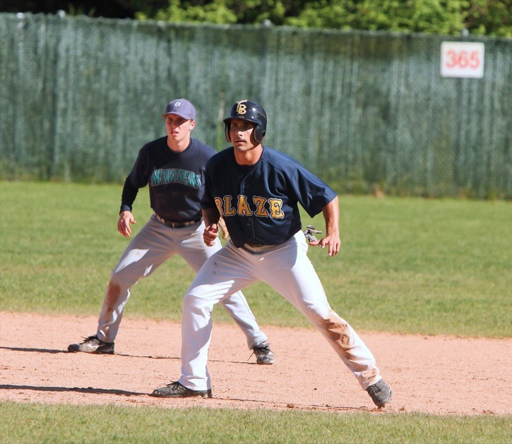 Langley Blaze's Mike Krische leads off second base during his team's game against the Victoria Mariners on Saturday at McLeod Park. After winning their host tournament last weekend, the Blaze went 2-1 in league play this past week.