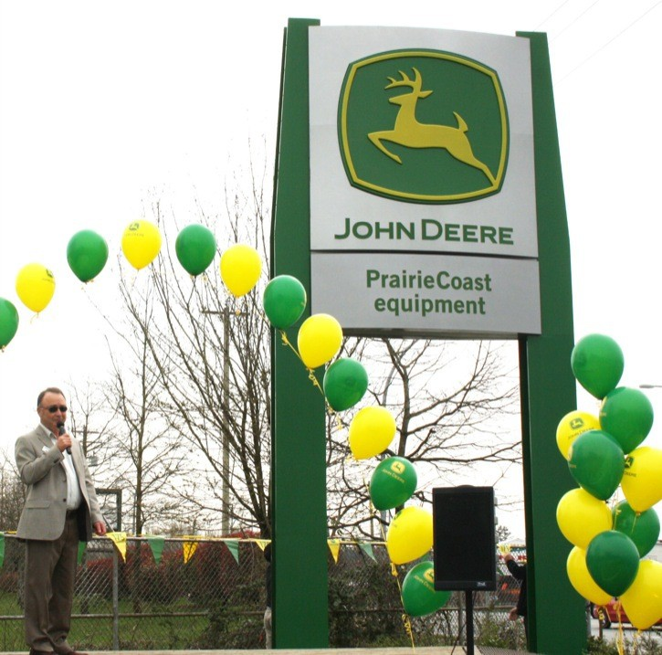 John Deere division sales manager Bob Jackson speaks at the official opening of PrairieCoast Equipment dealership's new facility at 22661 Fraser Highway.