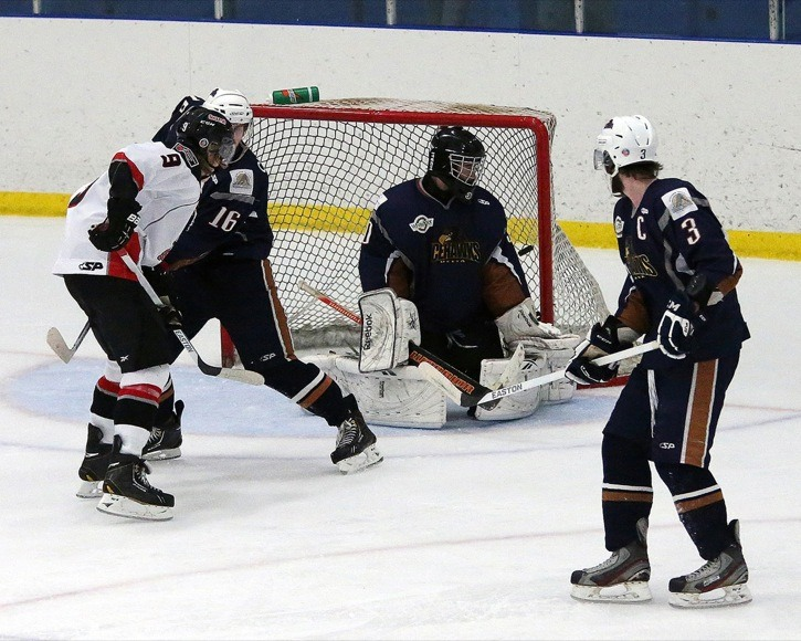 Danton Heinen (#9) provides a net presence as the puck gets past the Delta Ice Hawks goaltender during the 2013 PJIHL playoffs. Heinen helped the Richmond Sockeyes win the league championship, the Cyclone Taylor Cup and the Keystone Cup this past season.