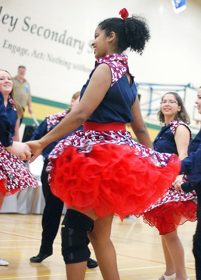 Tigist Asrate, a nine year veteran with the Delta Sundancers youth square dance club, performs in her home-sewn costume at Saturday's (May 3) Pacific Northwest Teen Square Dance Festival, held at Langley Secondary School. The costumes, made by parents, are kept top secret by each of the seven clubs in the competition until the day of the festival.