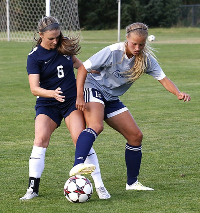 Trinity Western Spartans' Danae Derksen shields the ball from Western Washington's Erin Russell during pre-season action at TWU's Rogers Field last week (Aug. 20). The teams played to a 1-1 draw. The Spartans open the Canada West season on Sept. 11.