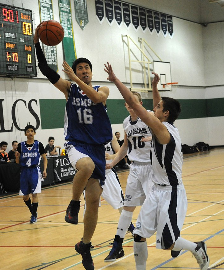 RE Mountain vs GW Graham in Fraser Valley AA senior boys basketball championships at Langley Christian Mountain Eagles Jeff Chen goes up for the shot during his team's 76-46 loss to the Graham Grizzlies during the Fraser Valley AA championships.