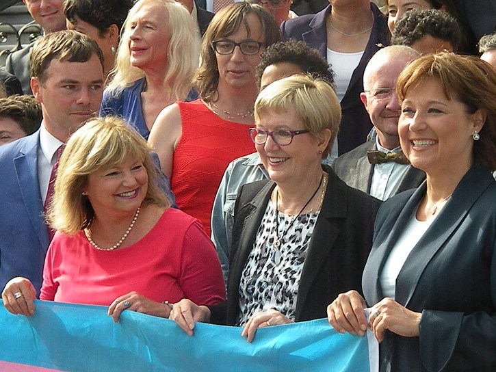 Premier Christy Clark joins Justice Minister Suzanne Anton, B.C. Liberal MLA Jane Thornthwaite, NDP MLA Spencer Chandra-Herbert and transgender rights advocates at the B.C. legislature Monday.