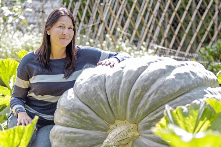 Brookswood resident Kate Mumford has grown a 650-pound (an estimate based on its measurements)squash in her back yard. She plans to enter it in the Oct. 11 giant pumpkin competition at Aldor Acres farm.