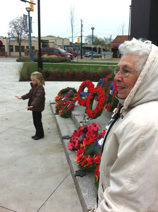 Laura Sim joins a little girl who asked the Sim family to sing O Canada along with her. It was a memorable Remembrance Day moment.