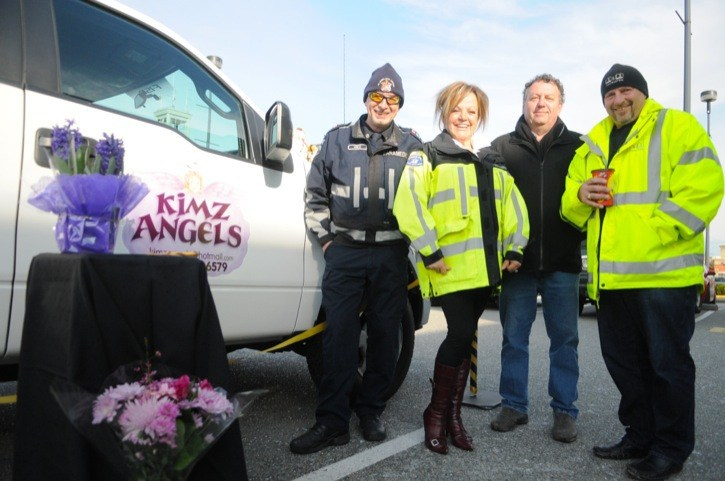 Paramedic Vince Ford, Kim Snow, Glen Folson of Auction Automotive and Steve Stew of B&B Contracting stand beside the new Kimz Angels truck, which will be used to pick up and deliver goods for needy people in Langley.